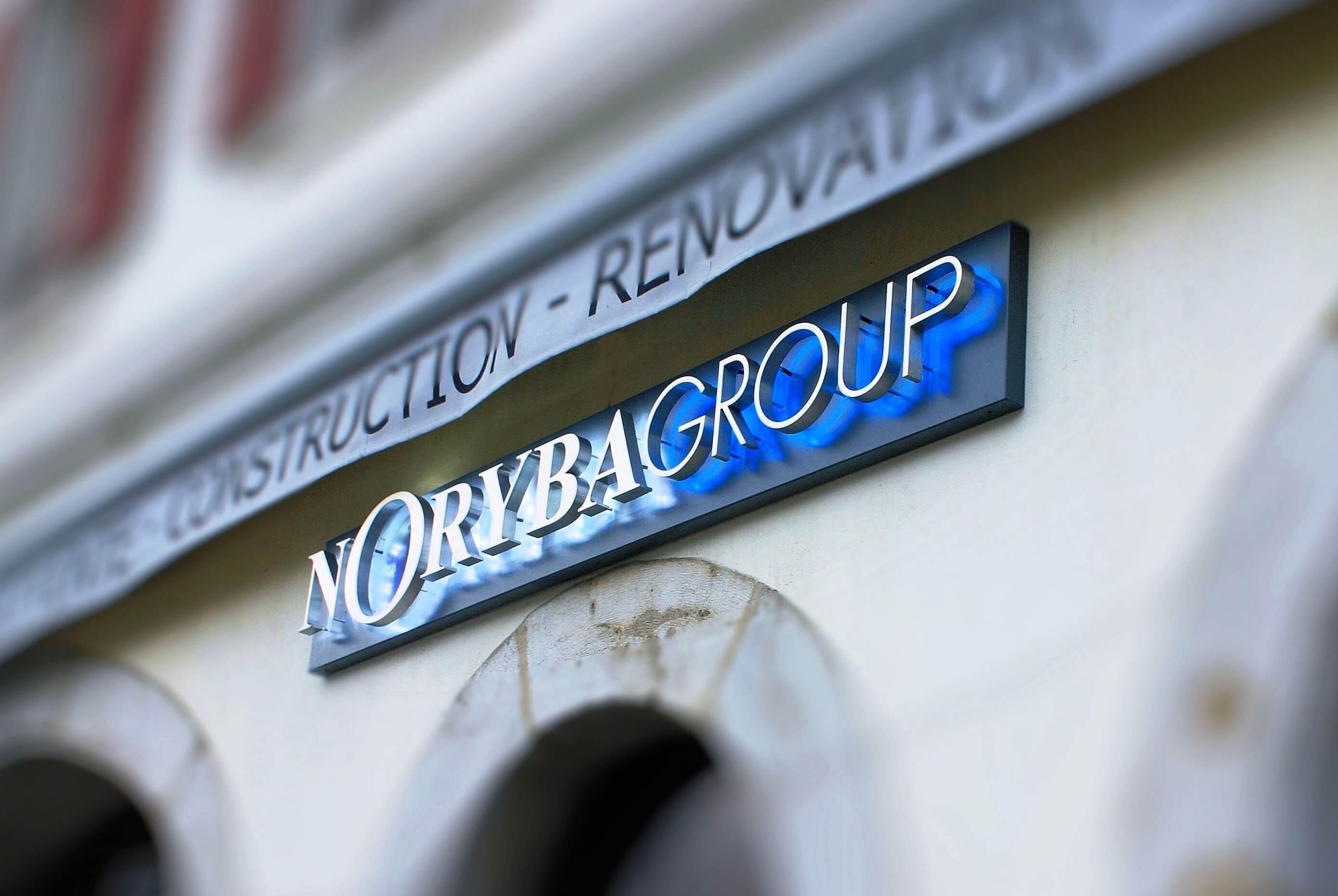 Enseigne agence immobilière Nyon B2 Real Estate