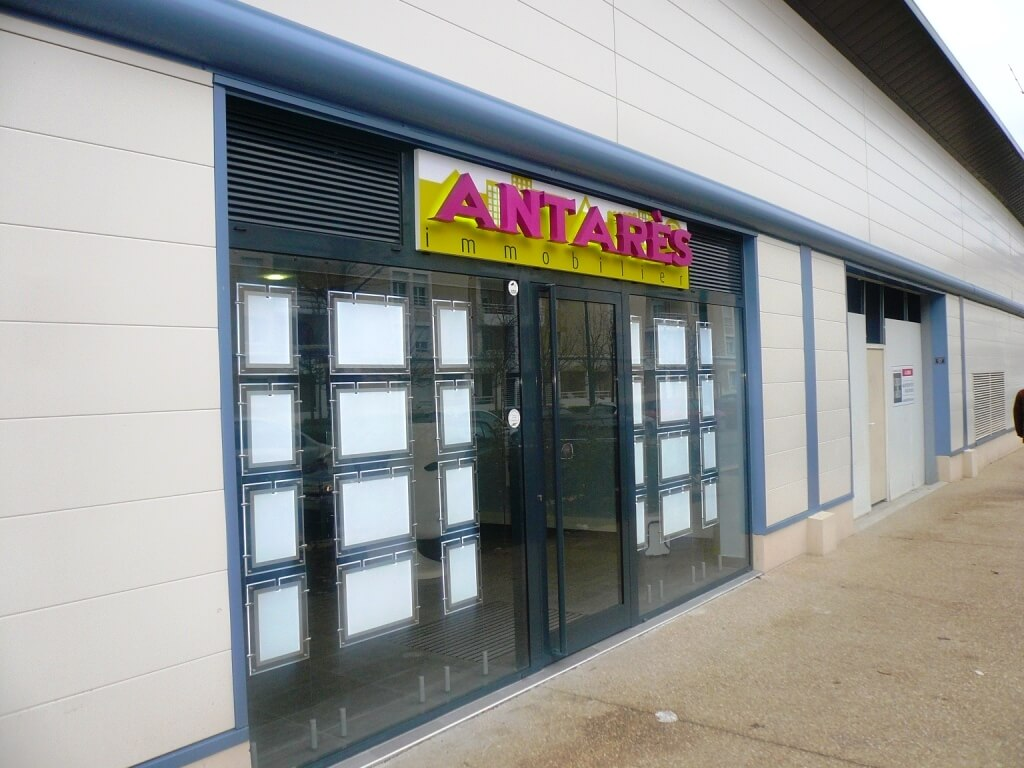 Enseigne agence immobili re antares immobilier a carri re for Agence immobiliere 01