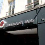 Détail de l'enseigne lumineuse avec éclairage led rouge et caisson lumineux rond elcairage led banche - Cercle de jeux Cadet Paris