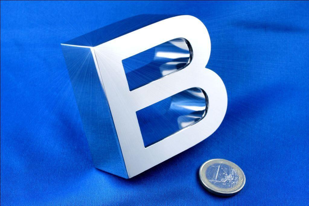 Fabrication lettres boitier inox poli miroir paris relief for Fabrication inox