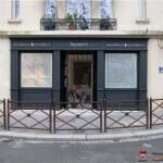 Vue de l'enseigne et façade - Agence immobilière à Neuilly-sur-Seine - Square International