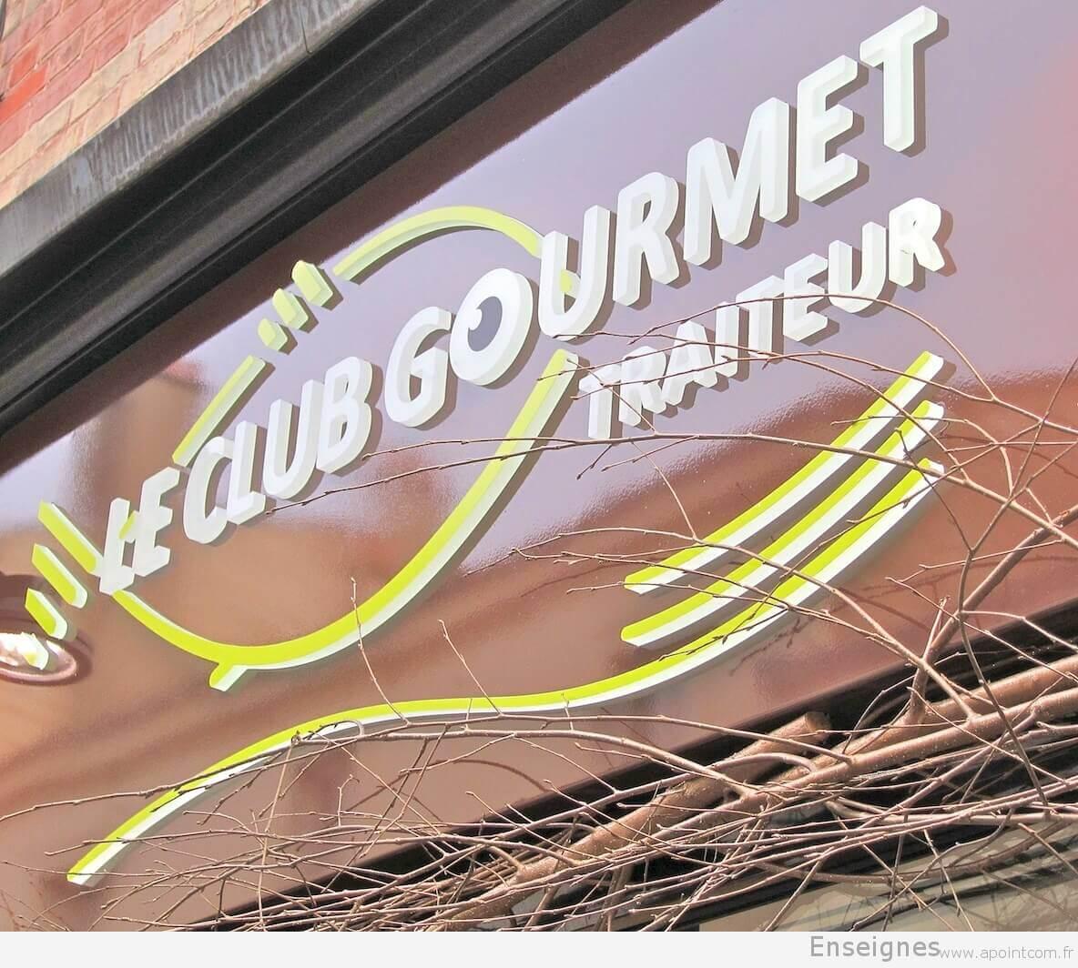 Détail relief de l'enseigne - Traiteur Le Club Gourmet