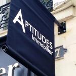 Drapeaux - Agence immobilière Aptitudes